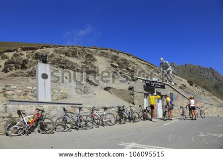 BAREGES, FRANCE, AUGUST 29:Cyclists and bicycles on the Col du Tourmalet (2115m),Central Pyrenees, in France.This is the highest point of a famous climbing route of Tour de France on August 29 2010 - stock photo