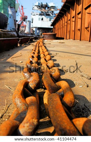 Barge and other ships standing at port dock - stock photo