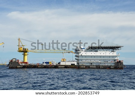 barge and tug boat in open sea,Oil and gas platform in the gulf or the sea, The world energy, Offshore oil and rig construction  - stock photo