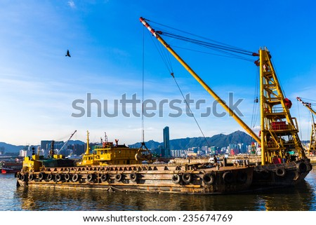 Barge dredging a harbor - stock photo