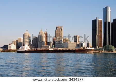 Barge in front of Detroit skyline - stock photo