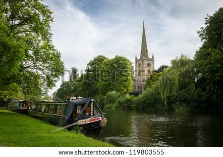 Barge mooring on the river Avon near Holy Trinity Church at Stratford-upon-Avon - stock photo