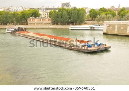 Barge navigates the Seine river in Paris, France - stock photo