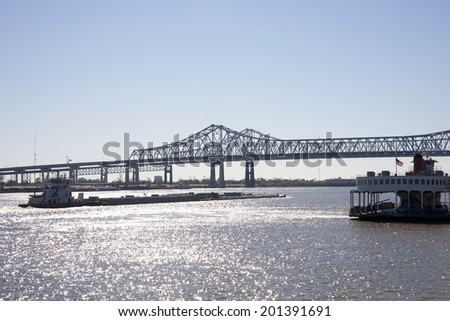 Barge navigating the Mississippi River near New Orleans, Louisiana - stock photo
