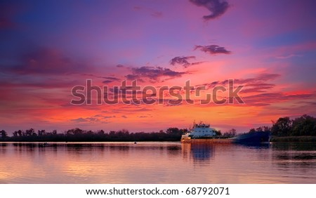 barge on the river. Evening - stock photo
