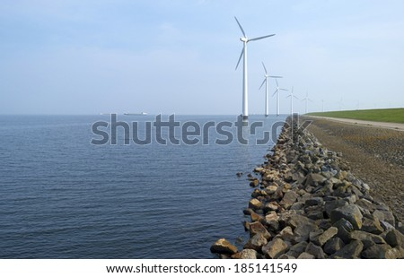 Barge sailing on the horizon of a lake in spring - stock photo