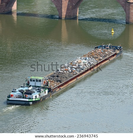 Barge transports waste on the river - stock photo