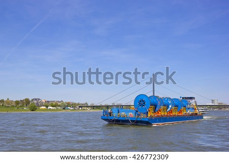Barge with huge industrial equipment on the Rhine in Dusseldorf, Germany - stock photo