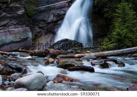 Baring Falls near Sunrift Gorge in Glacier National Park. - stock photo