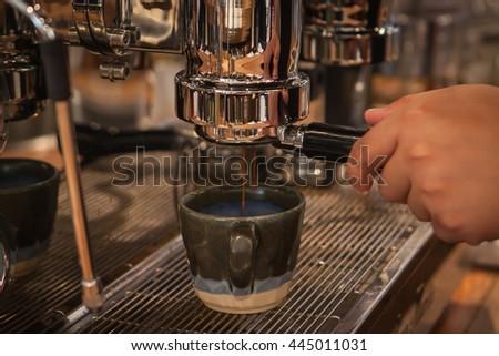 Barista Machine Coffee Counter Espresso Pour Concept. - stock photo