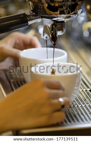 barista make espresso coffee - stock photo