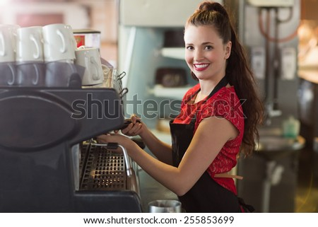 Barista making a cup of coffee at the cafe - stock photo