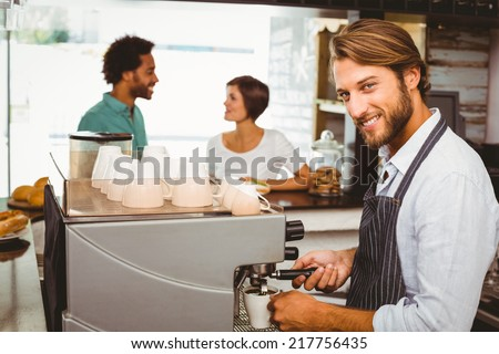 Barista making a cup of coffee at the coffee shop - stock photo