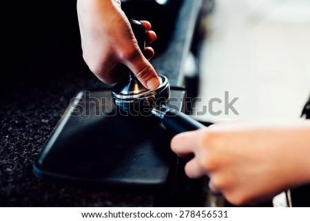 Barista preparing espresso - stock photo