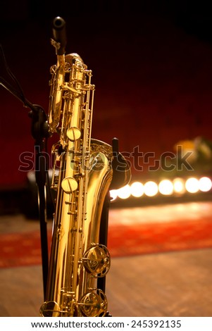 Baritone saxophone standing on stage - stock photo