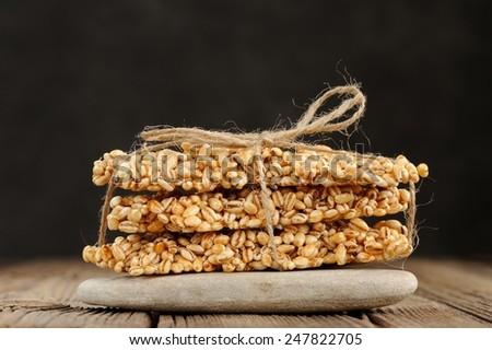 Barley granola bars in pile on rock - stock photo