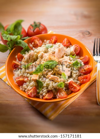 barley risotto with fresh salmon and tomatoes, selective focus
