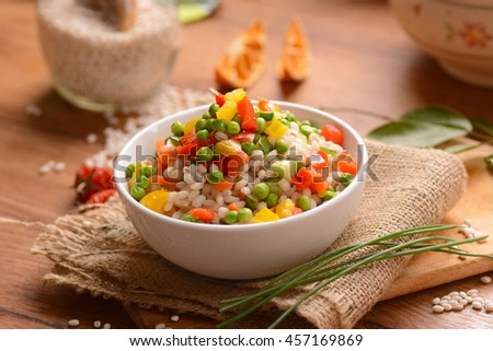Barley salad and assorted vegetables in white bowl