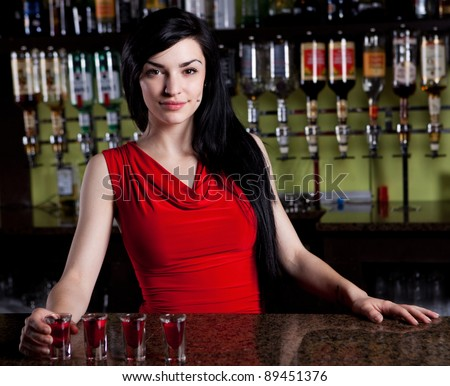 Barmaid in red - stock photo