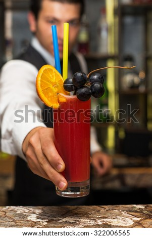 Barman at work, preparing cocktails. Serving bloody mary. concept about service and beverages. - stock photo