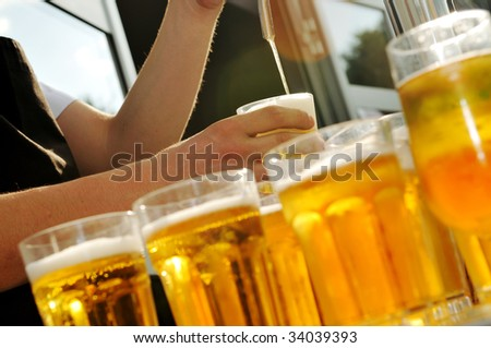 barman beer drink on buffet party background - stock photo