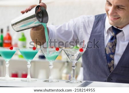 barman pouring a cocktail drink - stock photo