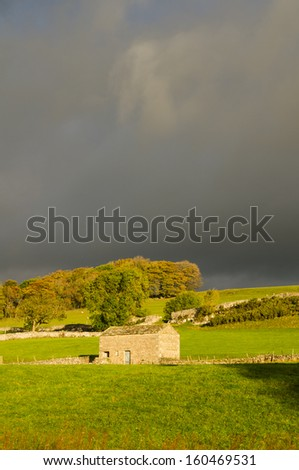 Barn and dark sky. Yorkshire Dales. UK - stock photo