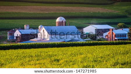 Barn and house on a farm in rural York County, Pennsylvania. - stock photo