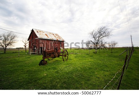 barn and old tractor - stock photo