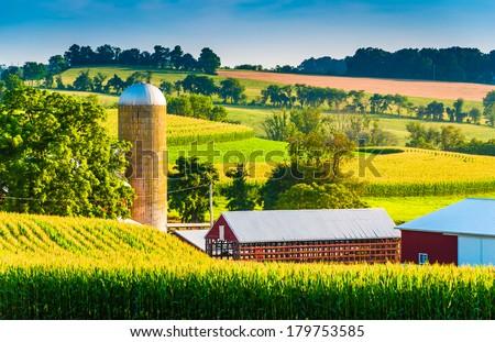 Barn and silo on a farm in rural York County, Pennsylvania. - stock photo