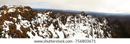Barn Bluff in snow and ice covered Cradle Mountain National Park Tasmania Australia