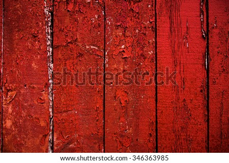 Barn board painted red and peeling