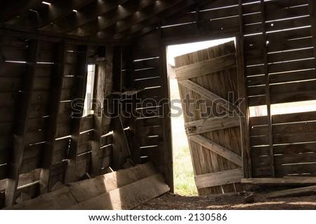 Barn door falling off its hinges - stock photo