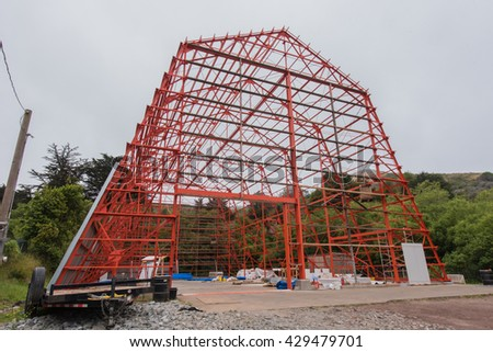 Barn structure of iron without walls during construction. - stock photo
