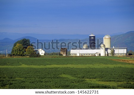 Barn with Adirondack Mountains in the background on Scenic Route 22A, VT - stock photo