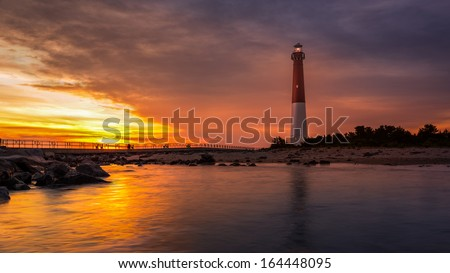 Barnegat Lighthouse at sunset.  Barnegat Lighthouse is a historic landmark located on the northern tip of Long Beach Island.