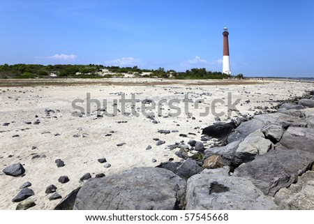 Barnegat Lighthouse seen from the New Jersey Shore.. Constructed in 1857, operational from 1958 to 1927. Barnegat Lighthouse is located in the town of  Barnegat Light, New Jersey - stock photo