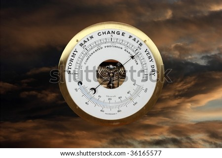 Barometer against a stormy sky - stock photo