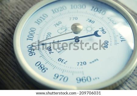 Barometer indicating atmospheric pressure reduction  - stock photo