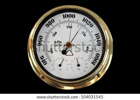Barometer on a black background. - stock photo
