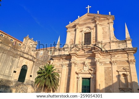 Baroque architecture of a church facade under blue sky in Dubrovnik, Croatia