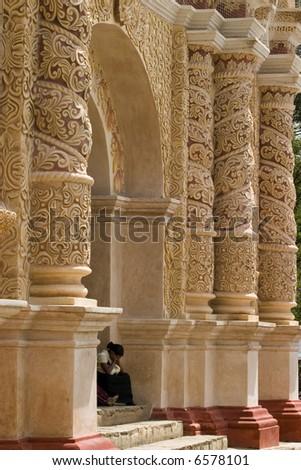 Baroque Church with Mayan woman - stock photo