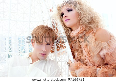 Baroque couple portrait with vintage vampire inspiration in hammock terrace - stock photo