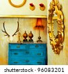 baroque grunge vintage house with blue drawer and golden mirror - stock photo