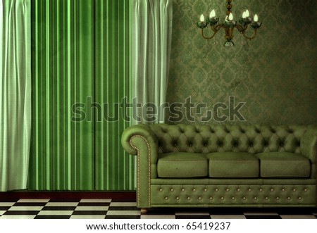 Baroque, Rococo inspired vintage interior featuring a chandelier and green leather sofa. - stock photo