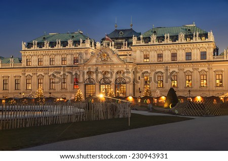 Baroque Upper Palace in historical complex Belvedere, Vienna, Austria at night during Christmas time. It is a popular touristic attraction with famous museum and beautiful park - stock photo