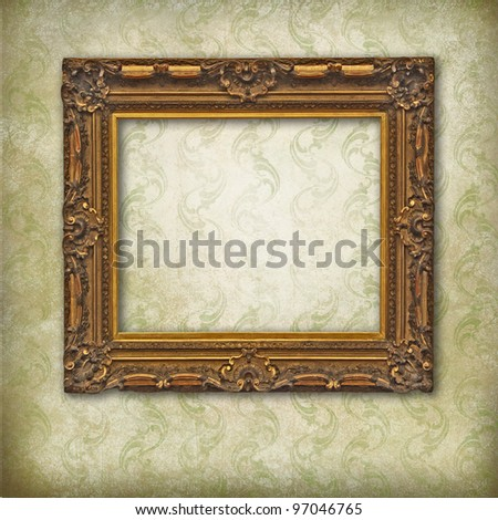 Baroque wooden frame on a Victorian grunge wallpaper - stock photo
