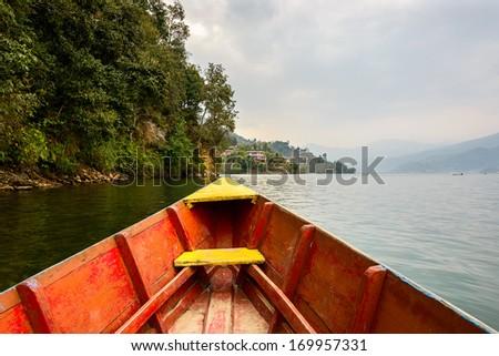 Barque on Phewa Lake in Pokhara, Nepal - stock photo