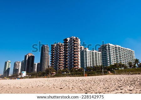 Barra da Tijuca Beach with Luxury Condominium Apartment and Hotel Buildings on Sunny Day in Rio de Janeiro, Brazil - stock photo