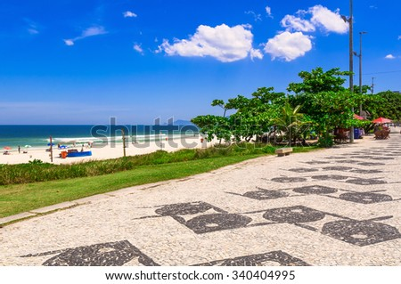 Barra da Tijuca beach with mosaic of sidewalk  in Rio de Janeiro. Brazil - stock photo